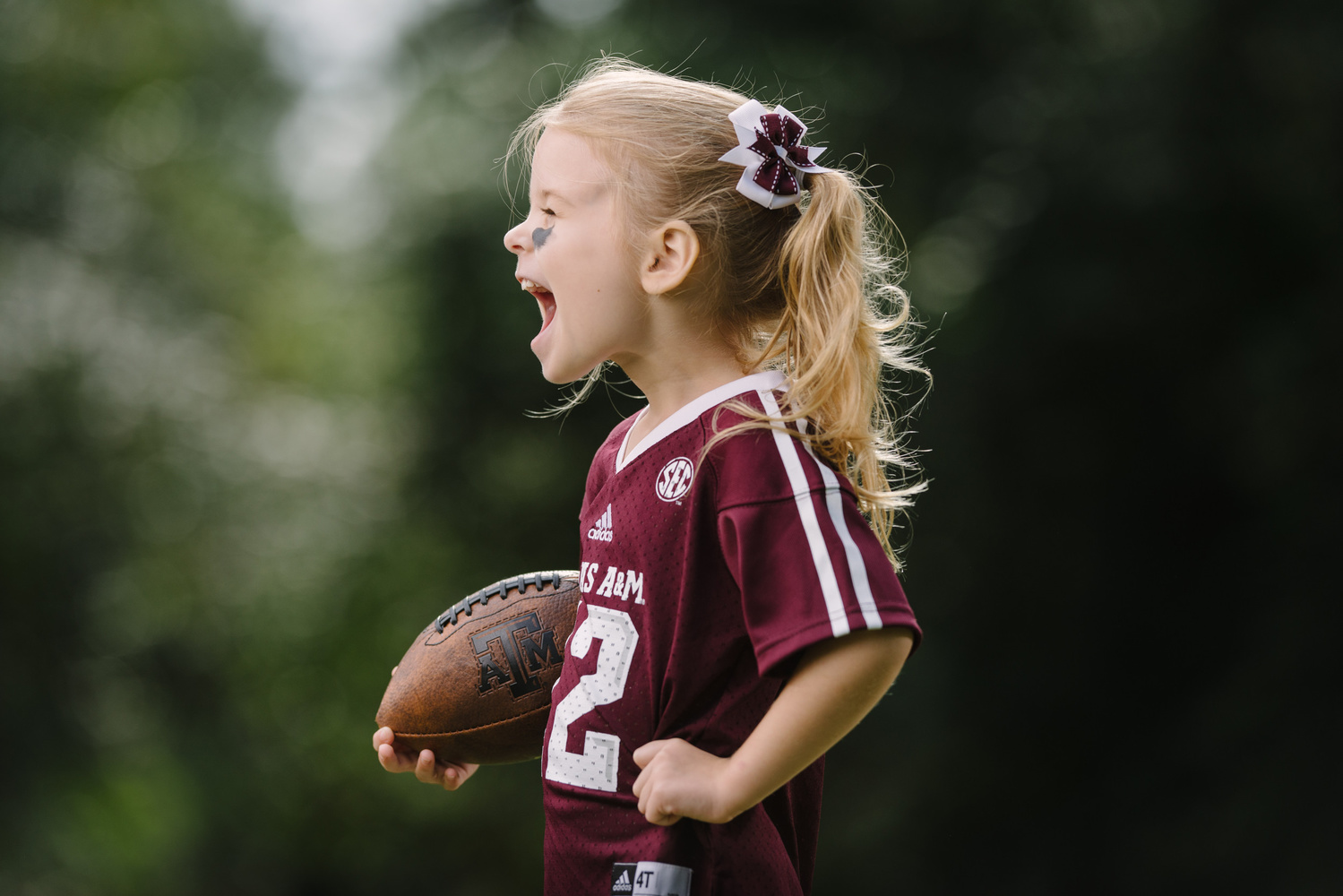 Portrait of a little girl in a football uniform