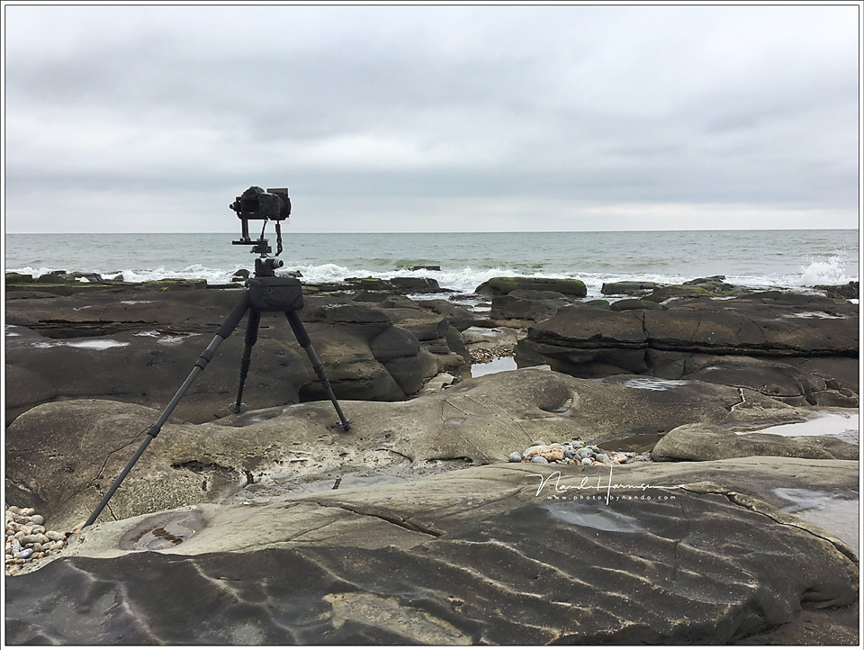 Although there is an uneven surface the tripod is placed level. This is the proper way.