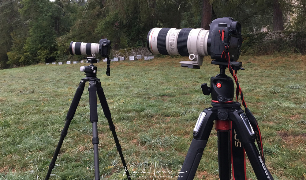 Can you image people can connect a camera onto a tripod like this? They do. The correct way is using the lens collar like the one in the back