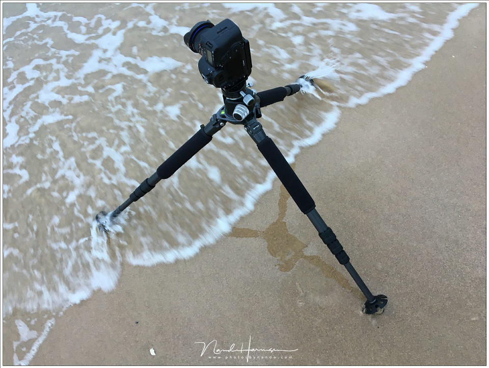 A perfect example how to place the legs of a tripod when it is standing in the wind or in a stream.