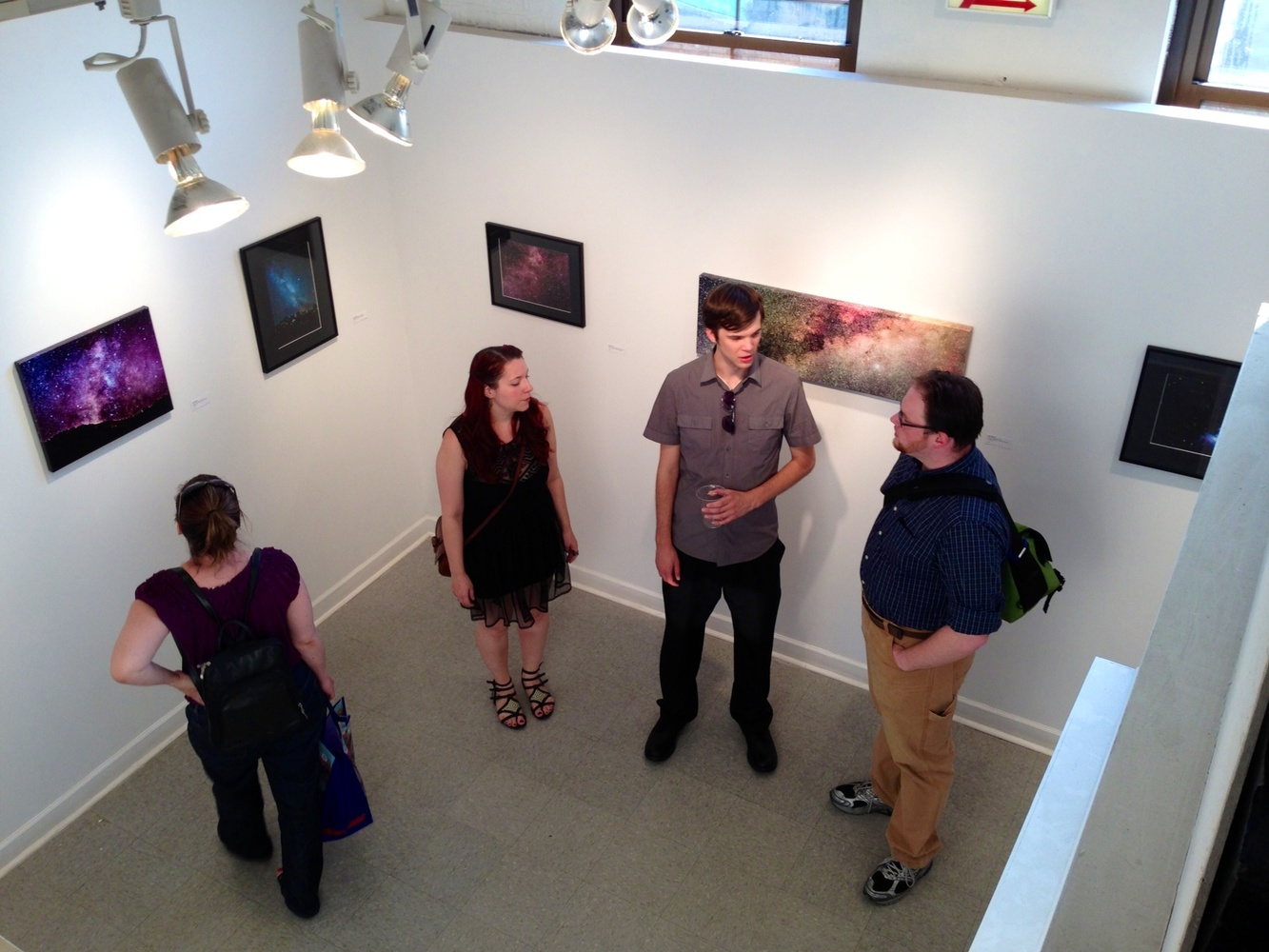 image of people standing around at an art gallery