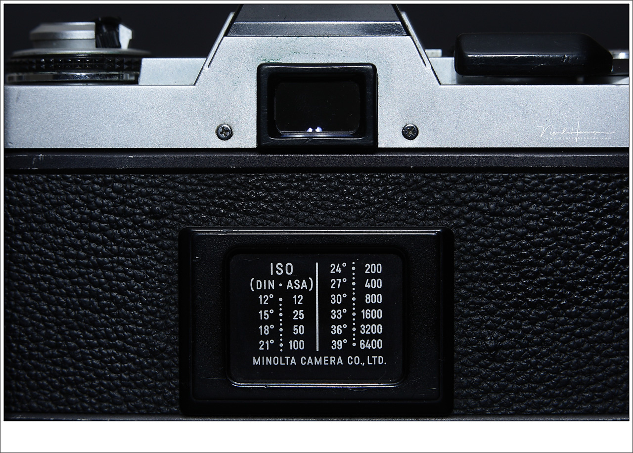 An old Minolta XG-1 with the ISO (DIN-ASA) table on the back. You had to set the film sensibility once for all the 12, 24, or 36 frames you had to your disposal.