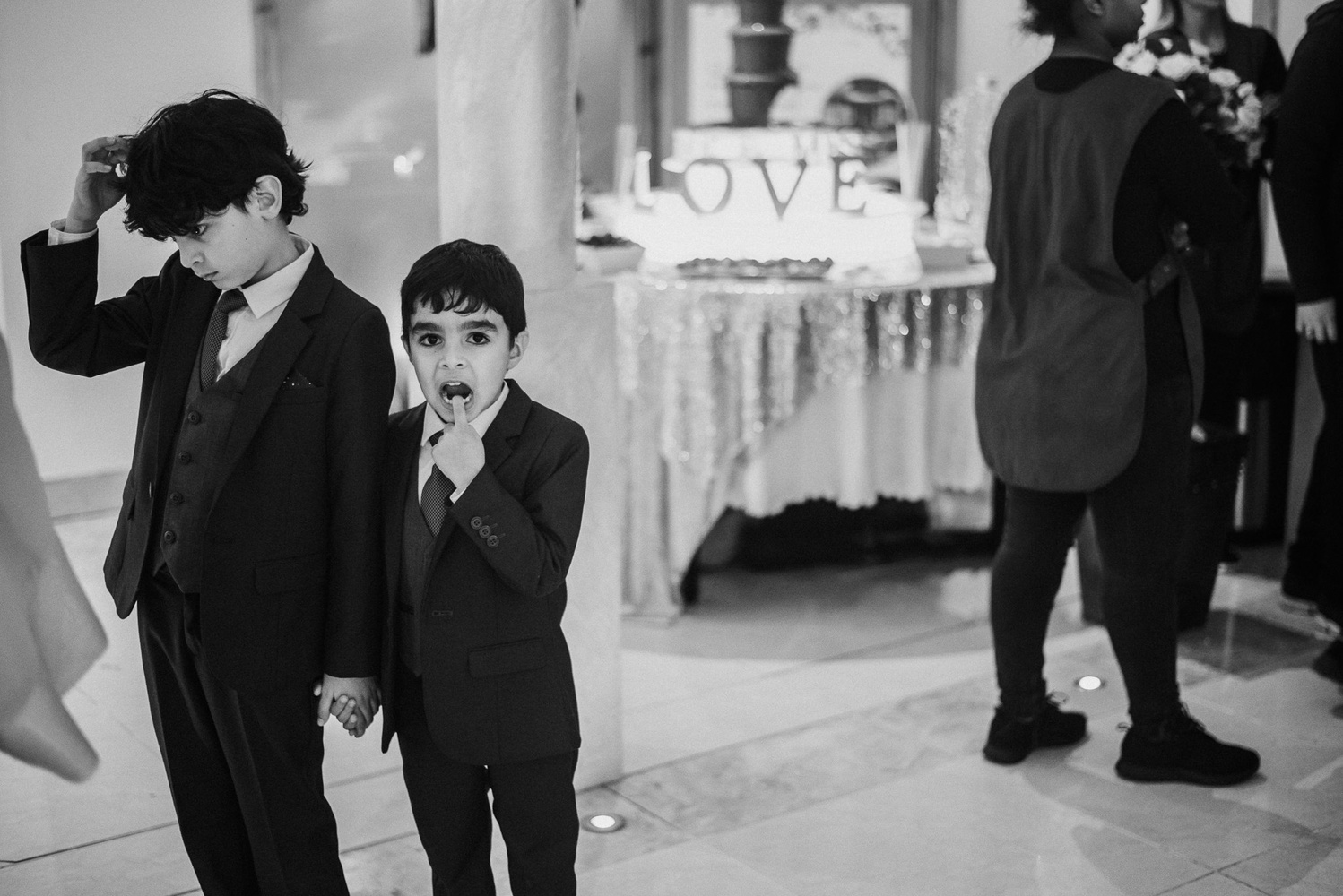Two young boys at a wedding.