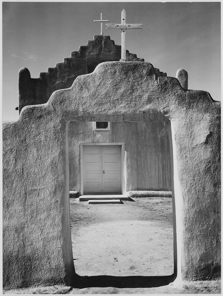Ansel Adams front view of church taos pueblo national landmark
