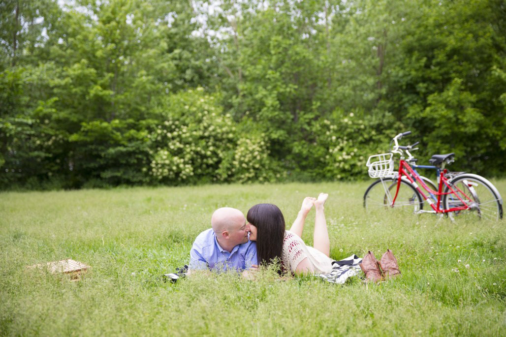 Couple kissing with bikes