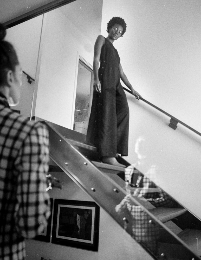 Monochrome photo woman walking down stairs