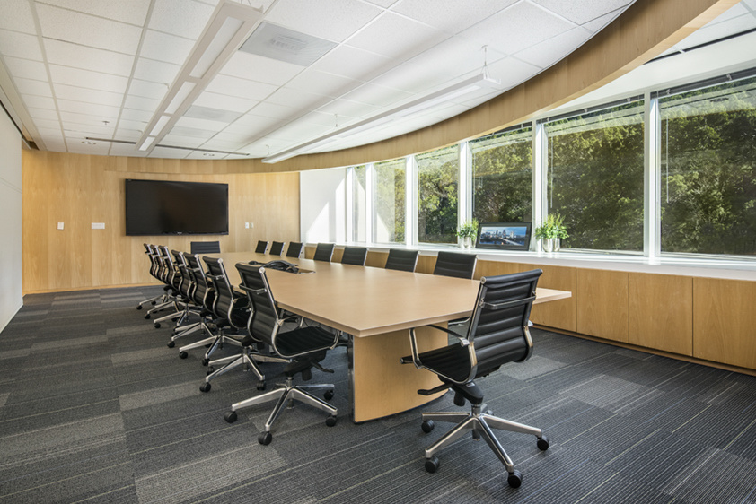 a meeting room with an empty conference table