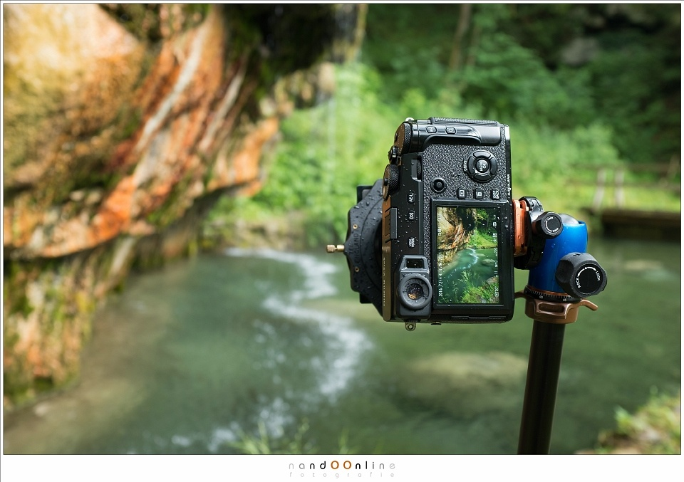 You need to turn on the mirrorless camera, just for finding a composition. This takes power from the battery. In this image you see a Fujifilm X-Pro2 that can switch between an optical viewfinder, and a electronic viewfinder. But with the filter holder in