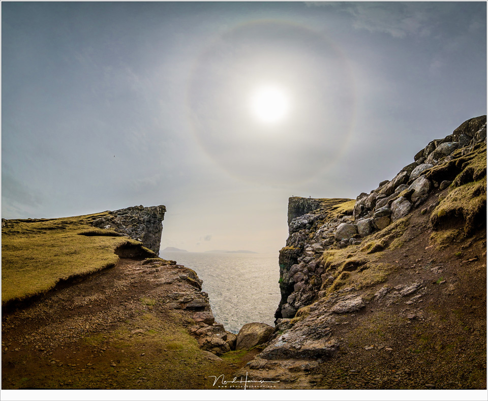A halo around the sun over Trælanípa at the Faroe Islands. Halos are more common than rainbows, they say. (Canon EOS 5D4 with Laowa 12mm | ISO400 | f/8 | 1/2000 | four vertical images stiched)