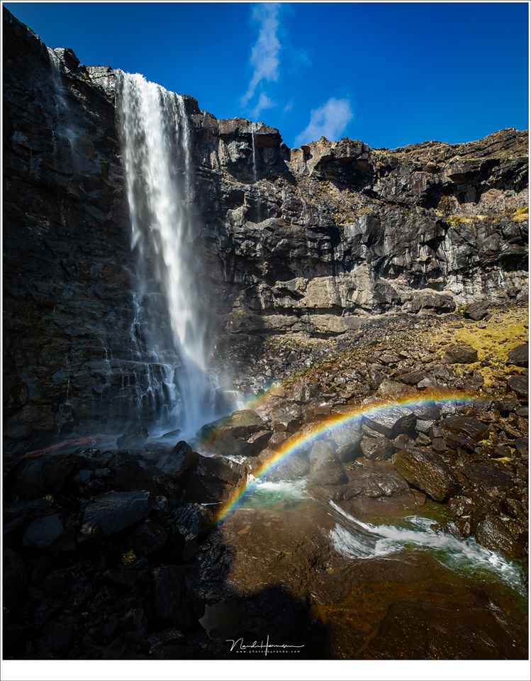 The largest waterfall of the Faroe Islands, called Fossá. I choose a location with the sun from behind to capture the spraybow (Canon EOS 5D4 with 16mm | ISO100 | f/9 | 1/25 | four horizontal images stitched)
