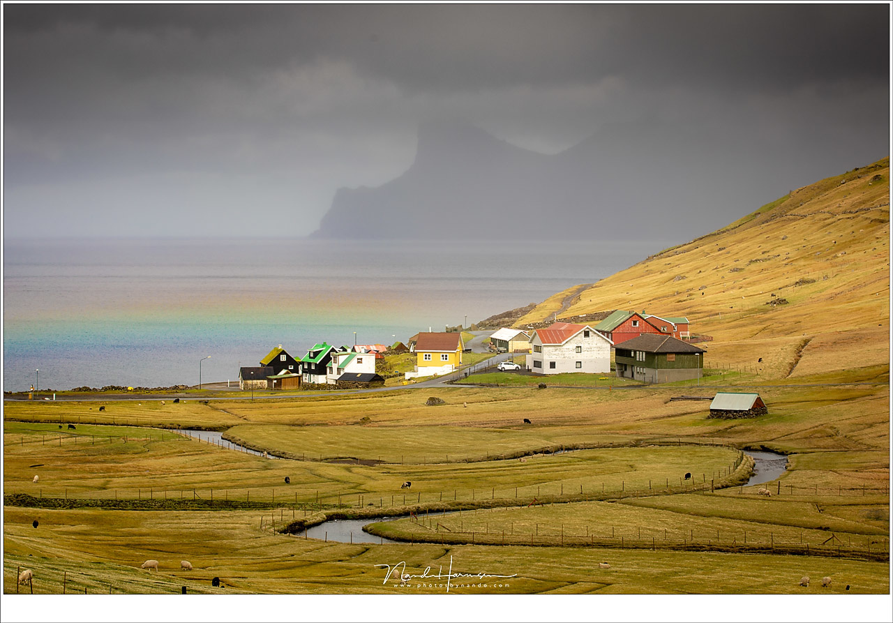 With the sun high above the horizon this rainbow appeared just above this small settlement at the Faroe Islands (Canon 5D4 with 90mm | ISO200 | f/9 | 1/125)