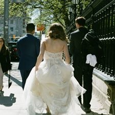 bride and groom walking down the street after wedding