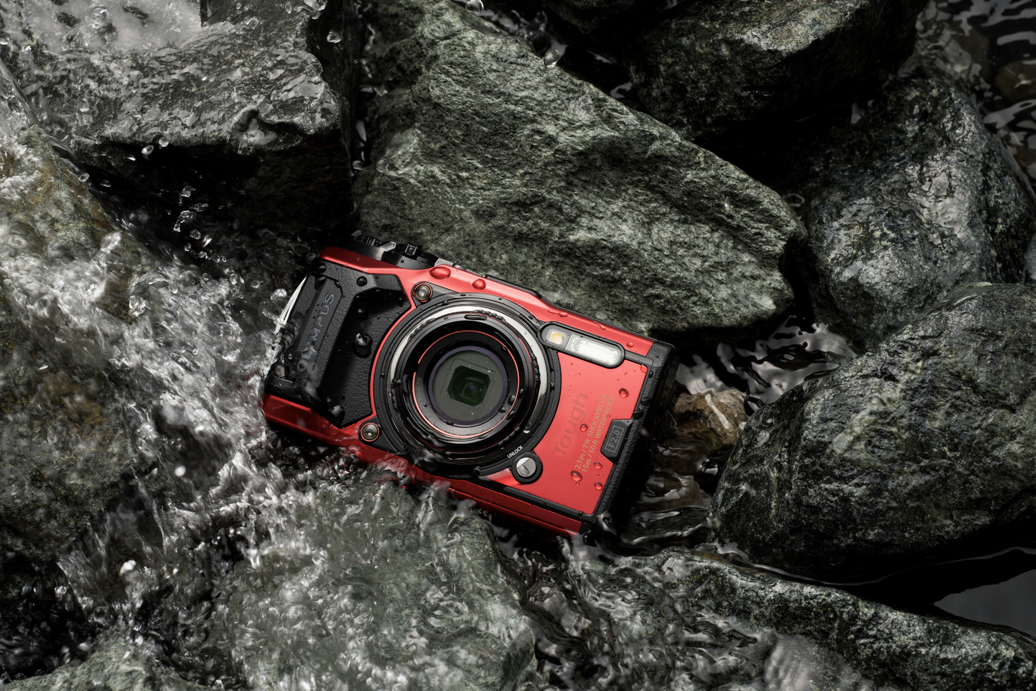 cover photo of the Olympus TG-6 on rocks with water