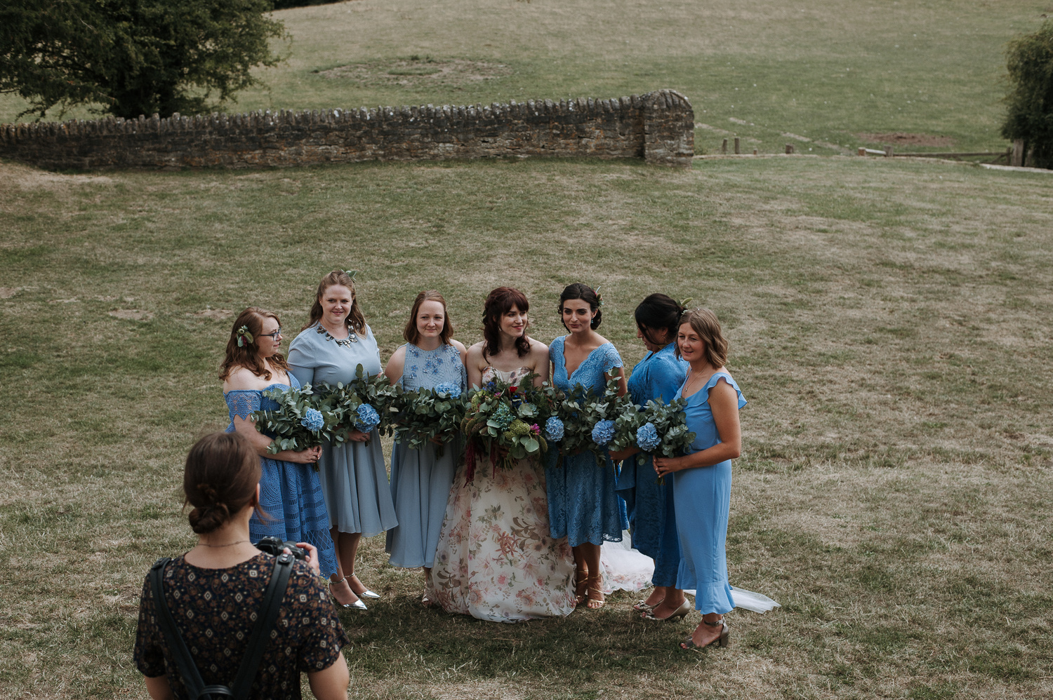 A group shot of bridesmaids and bride.