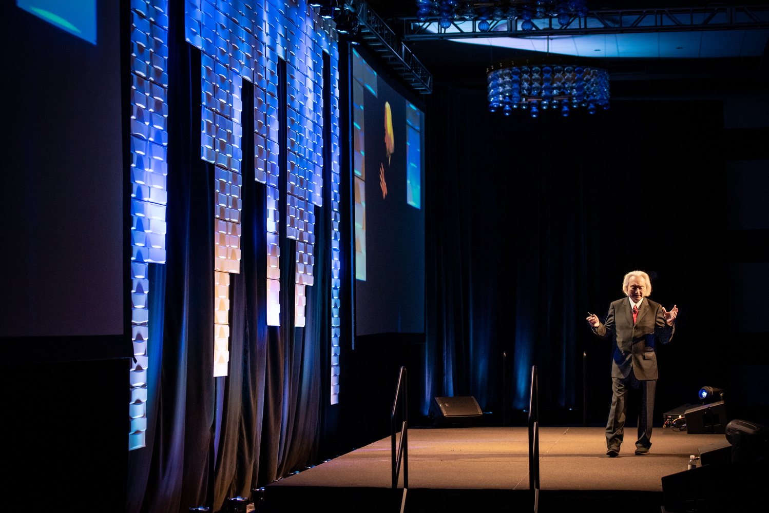 Michio Kaku delivers a speech on stage