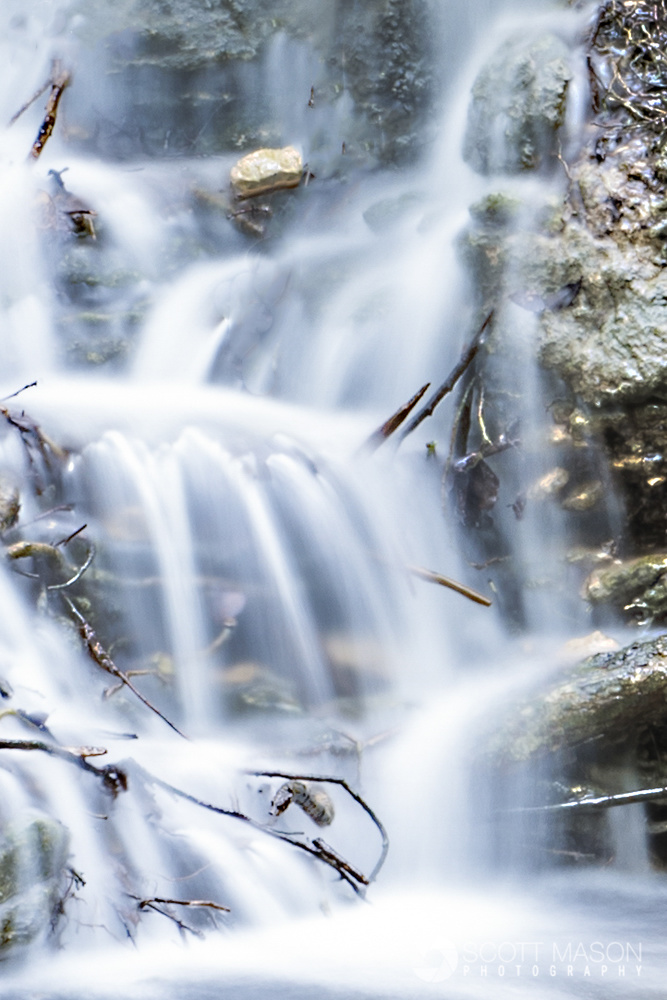 an image of a waterfall with silky water