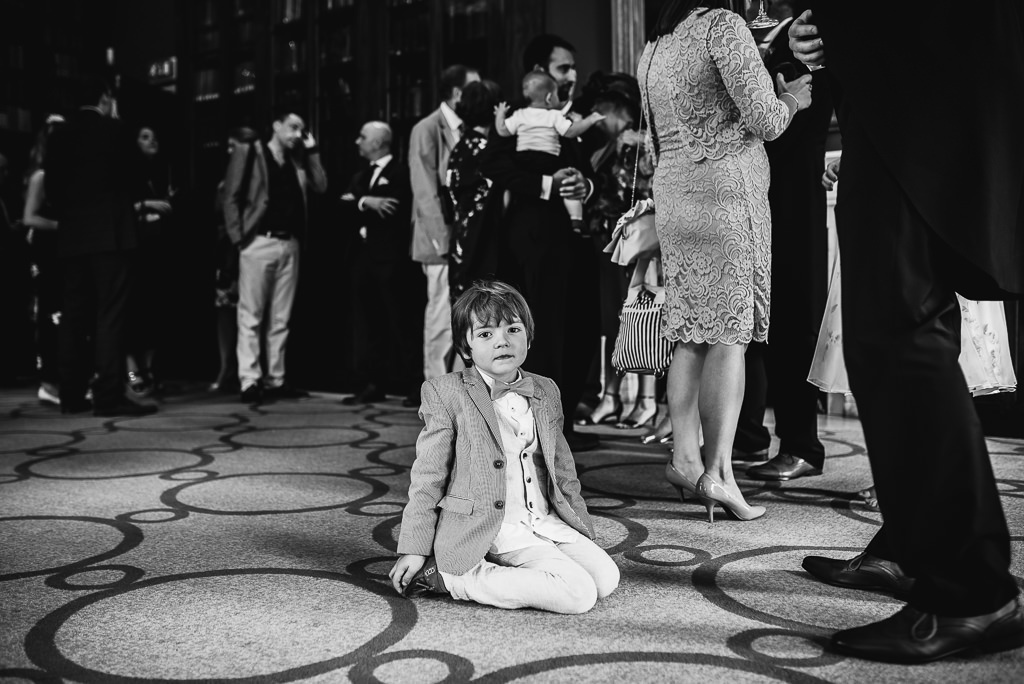 A young boy sat down at a wedding