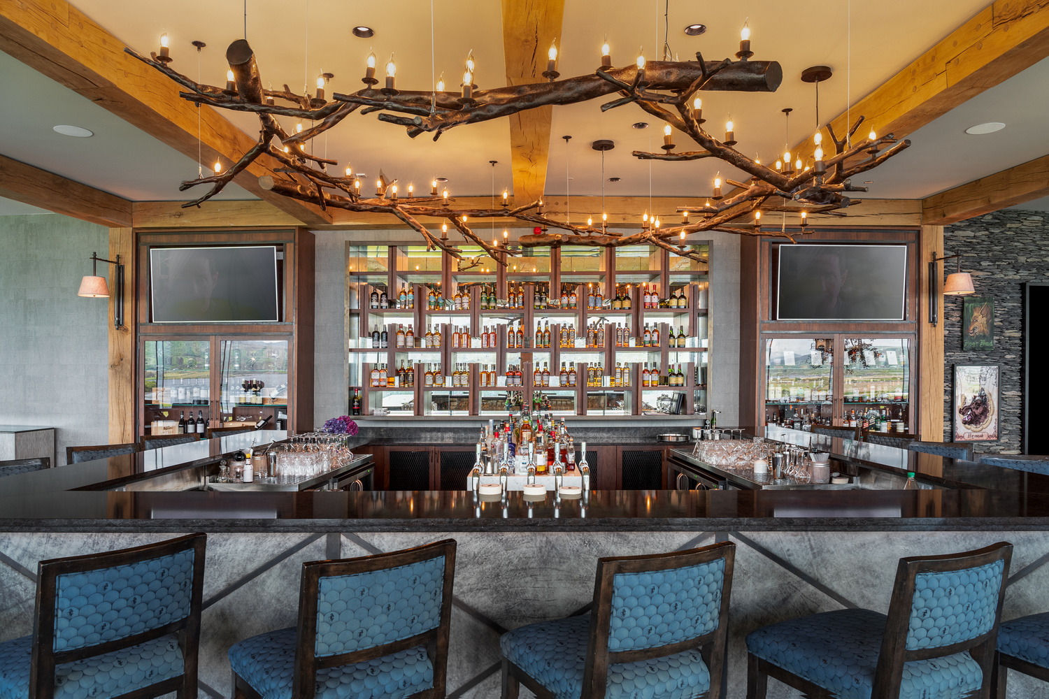 hotel bar with high stool seating and oak-wood timber beams above