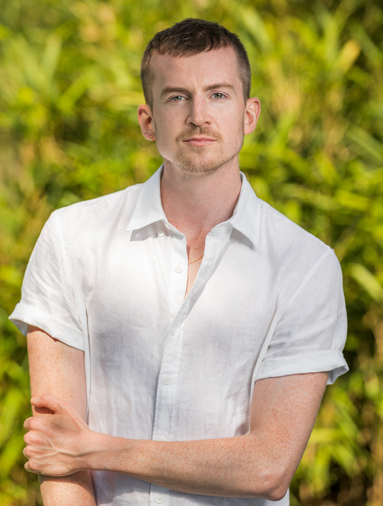 professional head shot of a thin male with broad shoulders