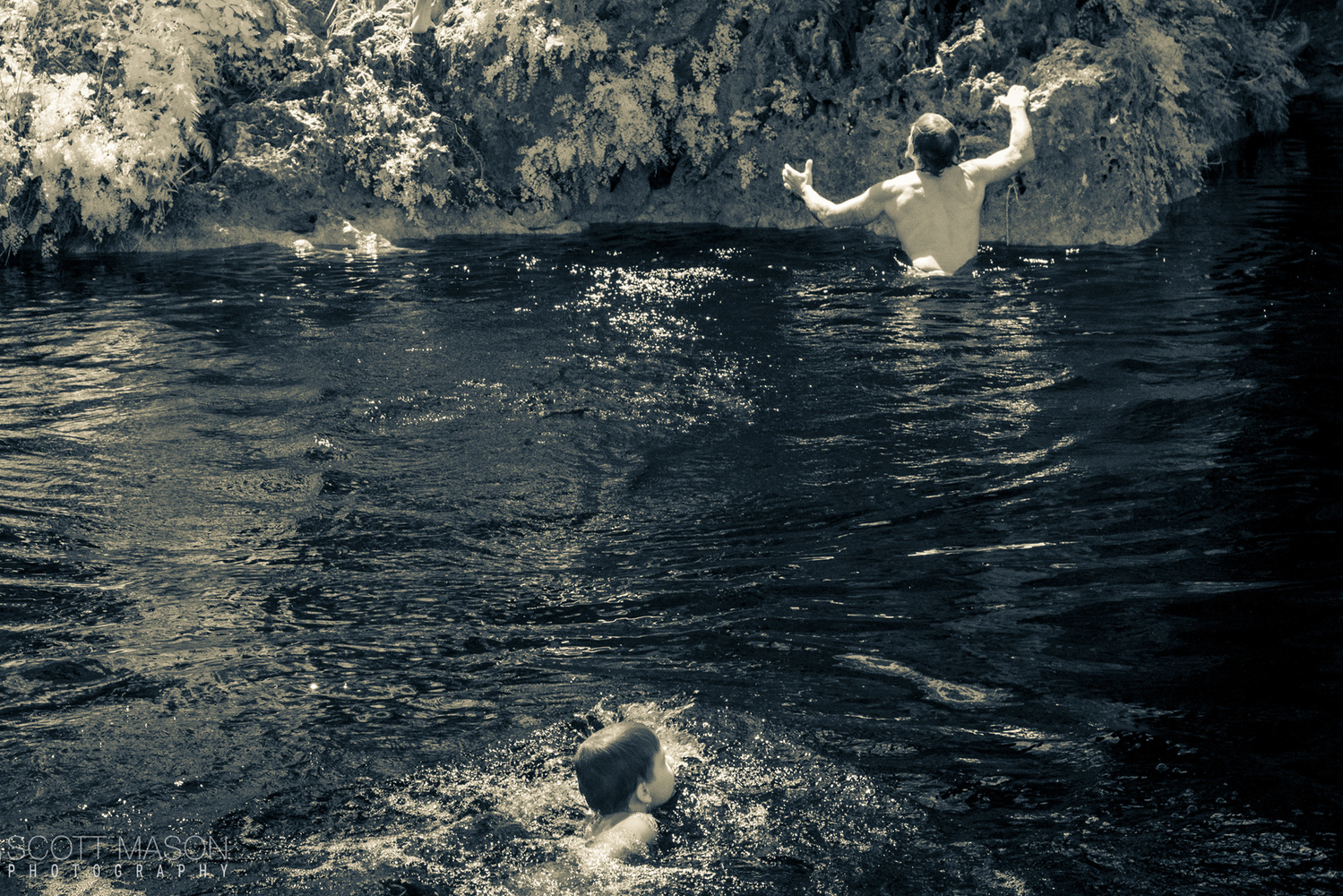 kids swimming in at Krause Springs, infrared