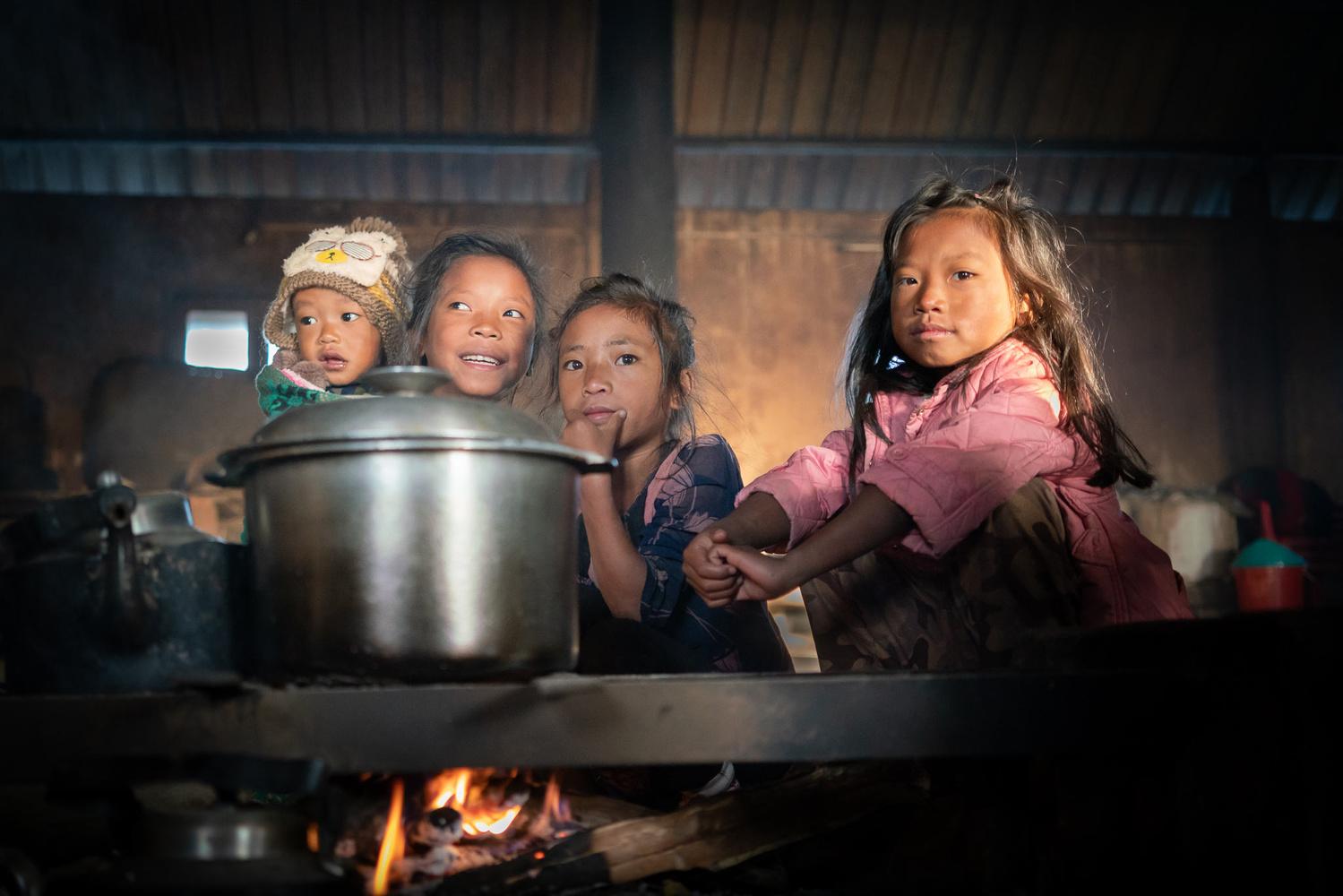 Young children in a village kitchen