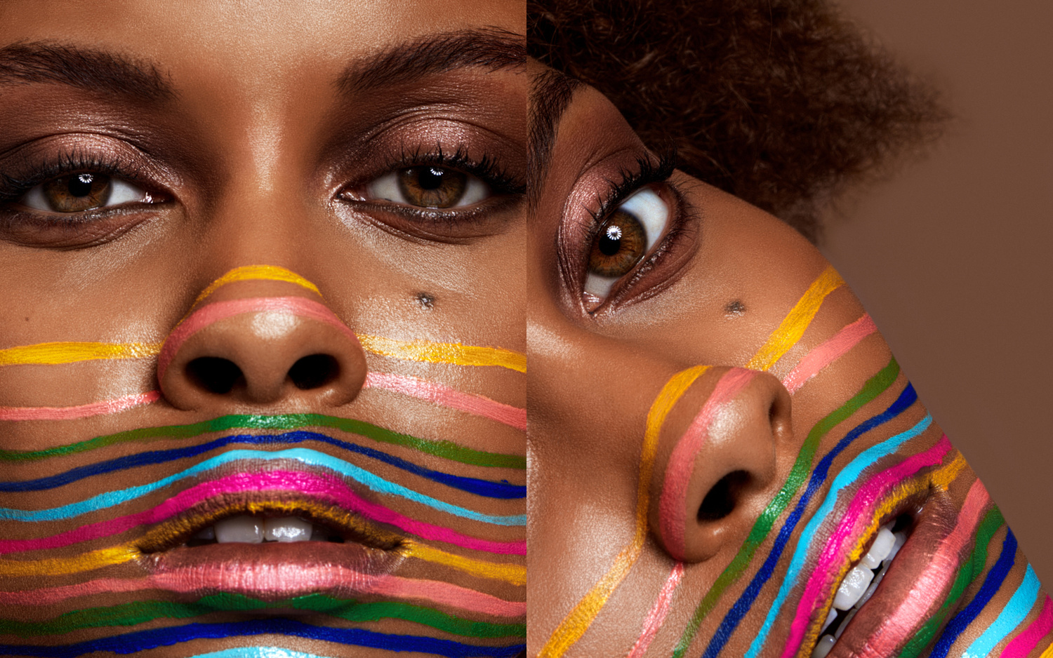 Beauty photo of model with color lines drawn on face
