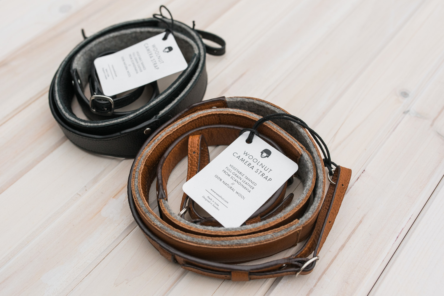 Black and brown leather camera strap