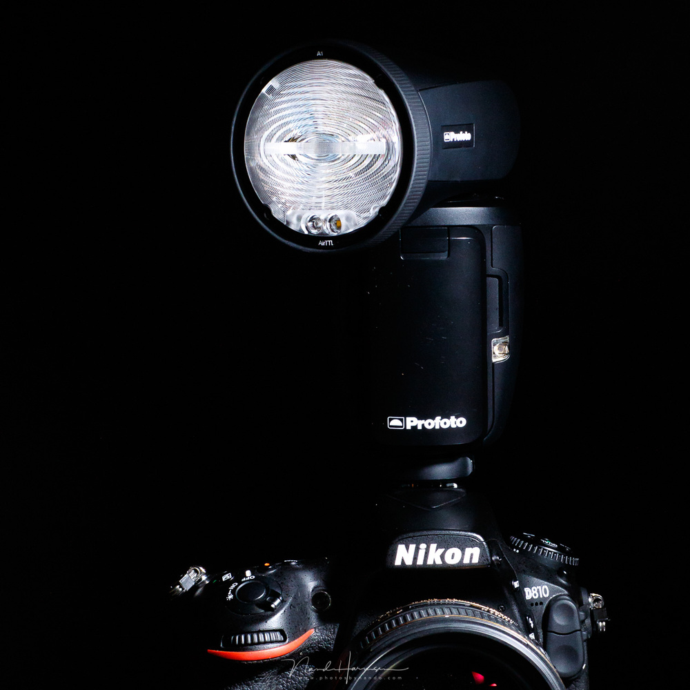 A modern on-camera flash with a swivel head that enables you to direct the light.