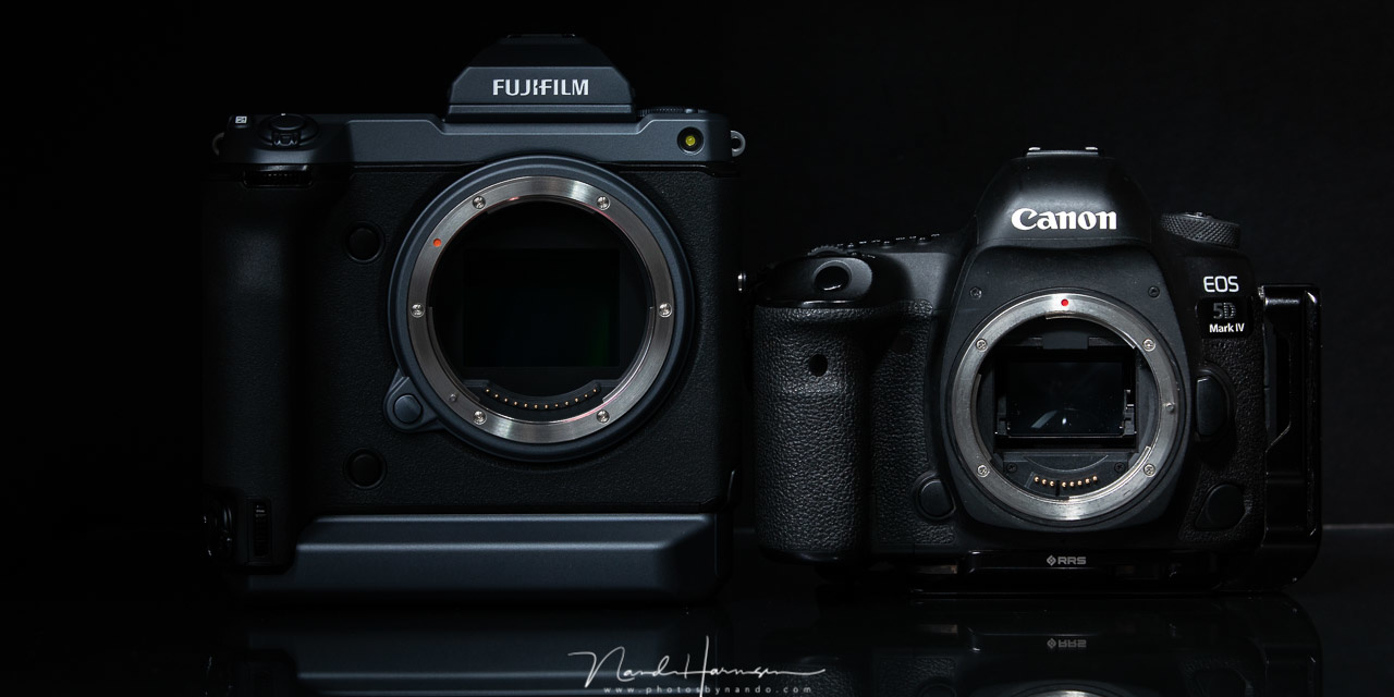 The 102 megapixel Fujifilm GFX100 next to the 31 megapixel Canon EOS 5D mark IV. If I had to choose I would grab the Canon any time. The resolution of that camera is more than enough and its price is much more reasonable.