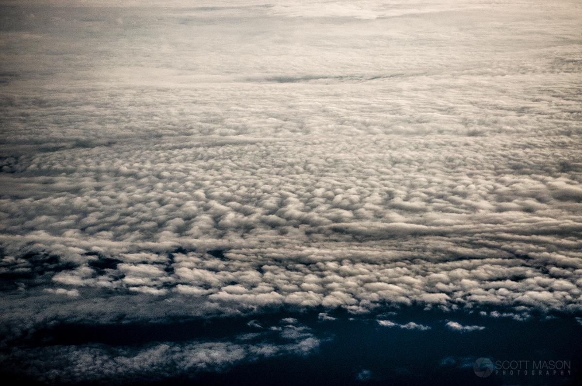 view from an airplane window of clouds below