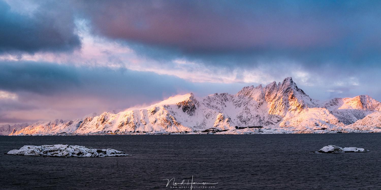 Sunrise at Lofoten. (63mm, ISO640, f/8, 1/60s handheld)