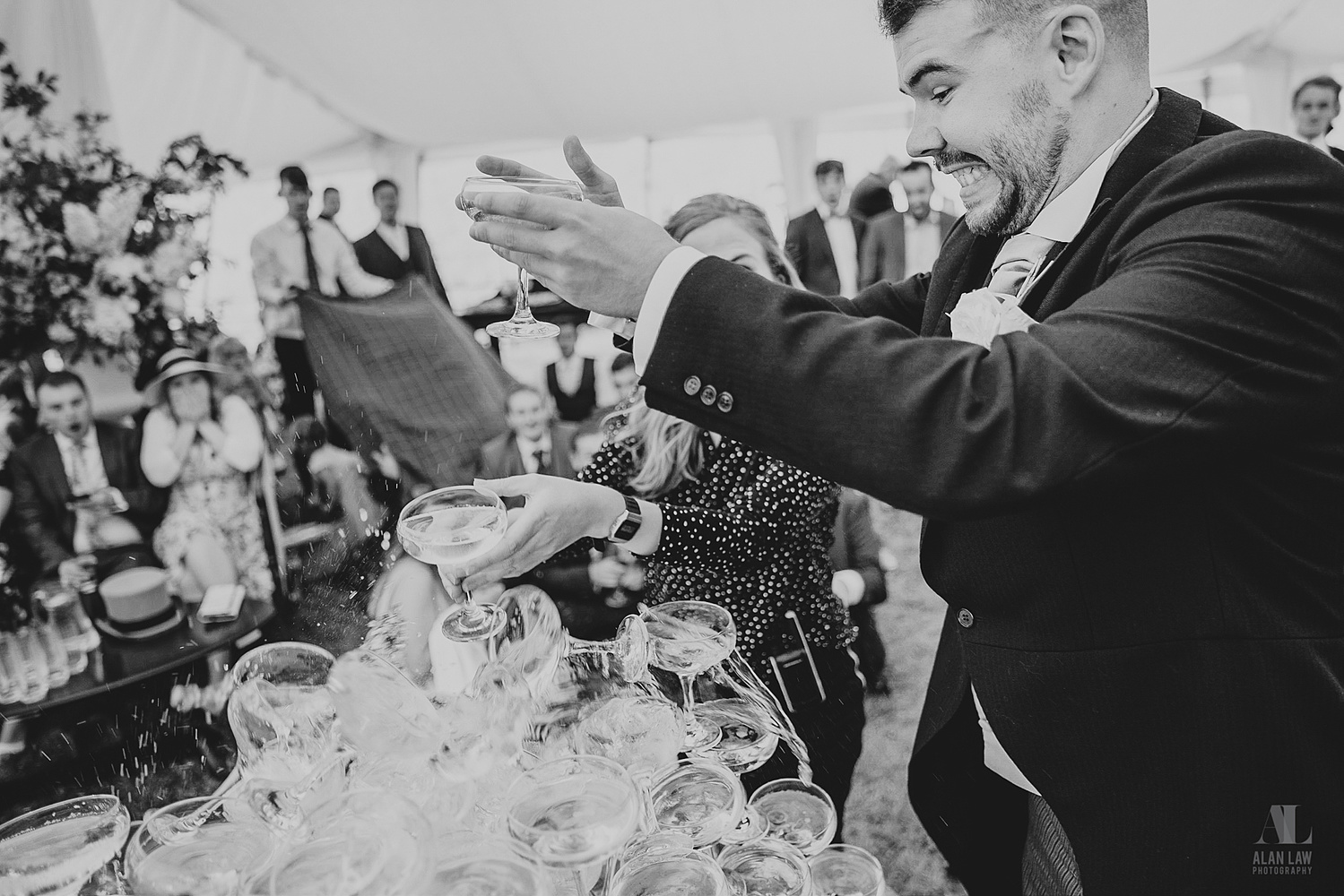 A goom dropping wedding toast glasses.