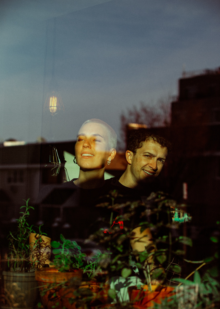 A couple photographed through their window pane in Brooklyn for the Come To My Window during COVID-19