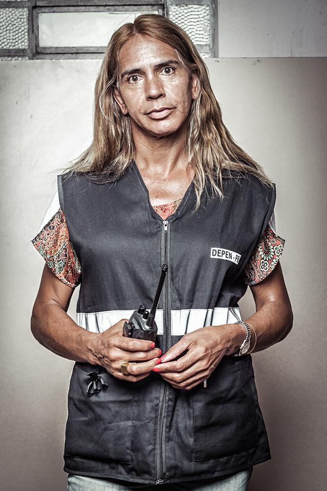 A female guard inside a prison.