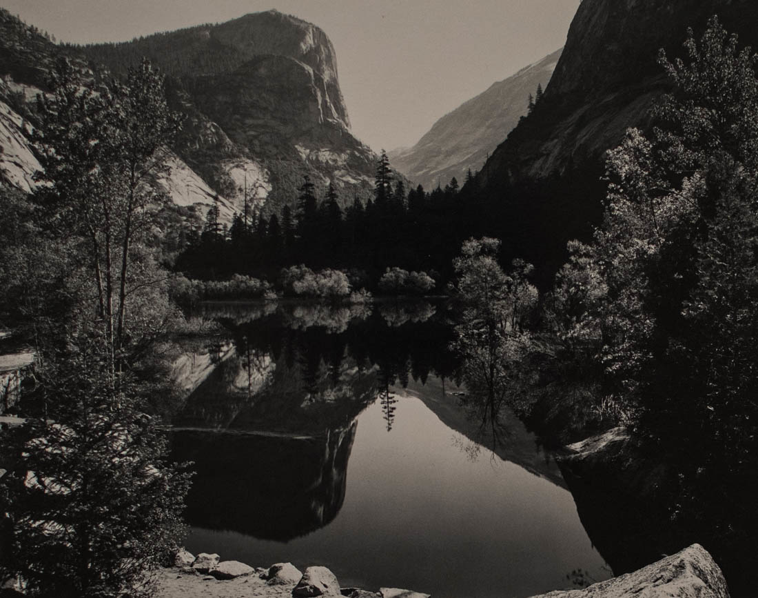 an Ansel Adams image of a mountain scene mirrored in a lake