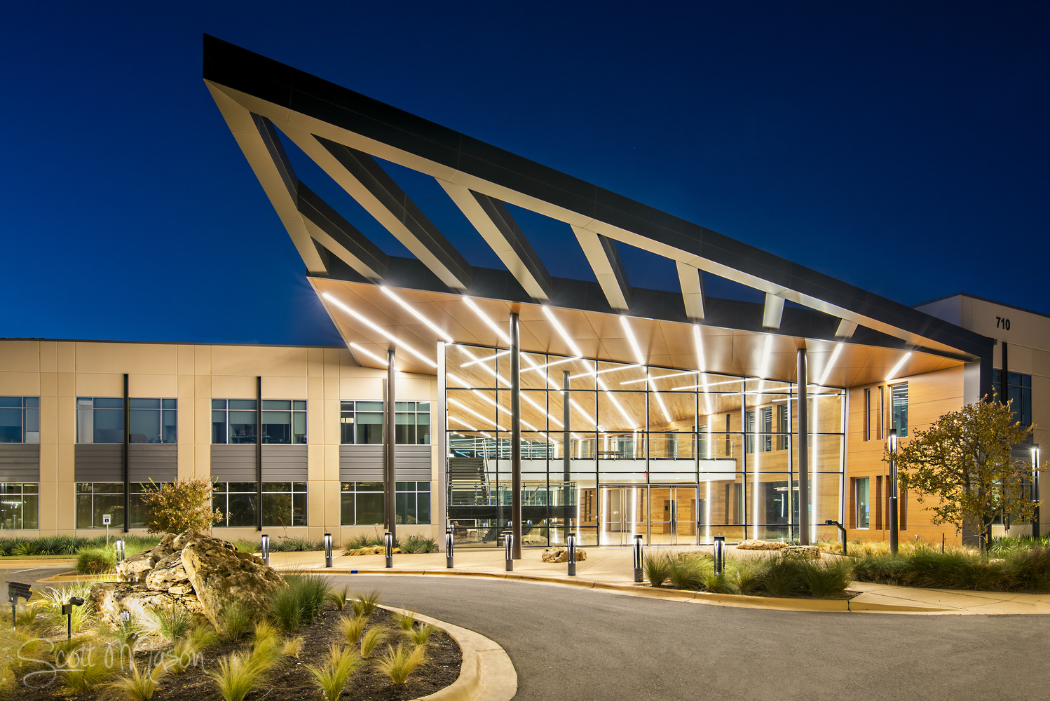 an exterior architectural photo of an office at twilight