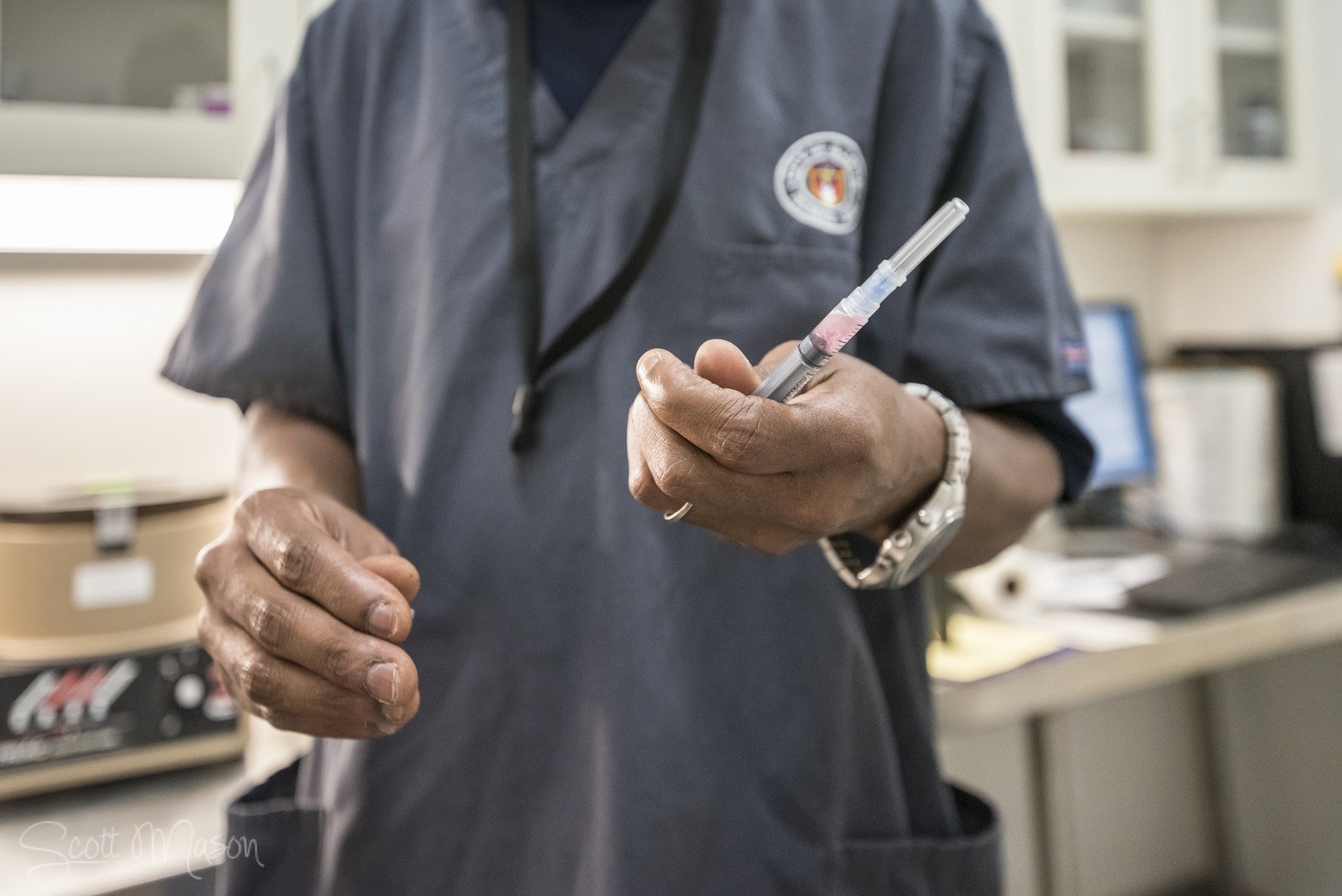 a healthcare working holding a syringe with a vaccine