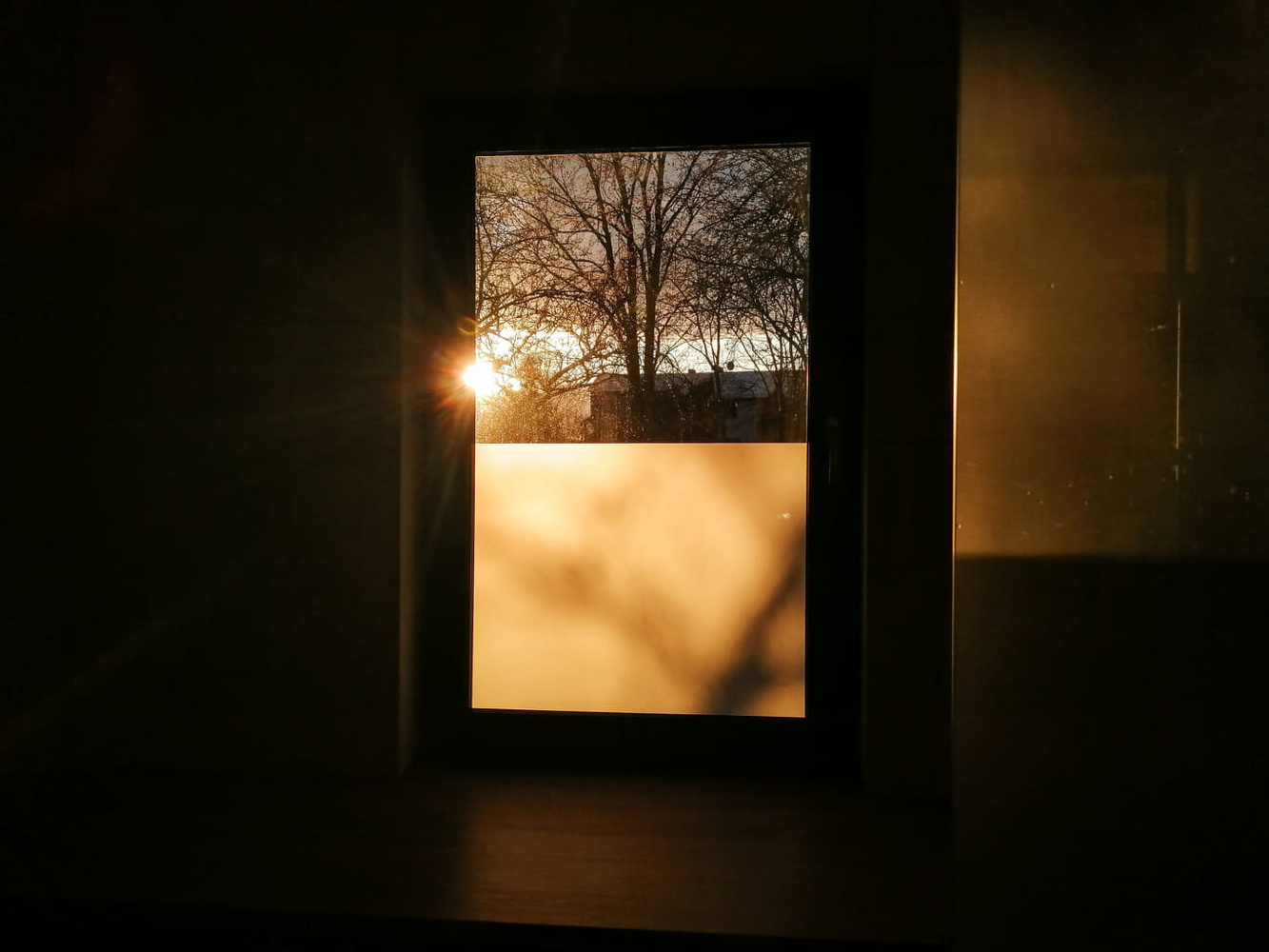 A sun rise coming through the window