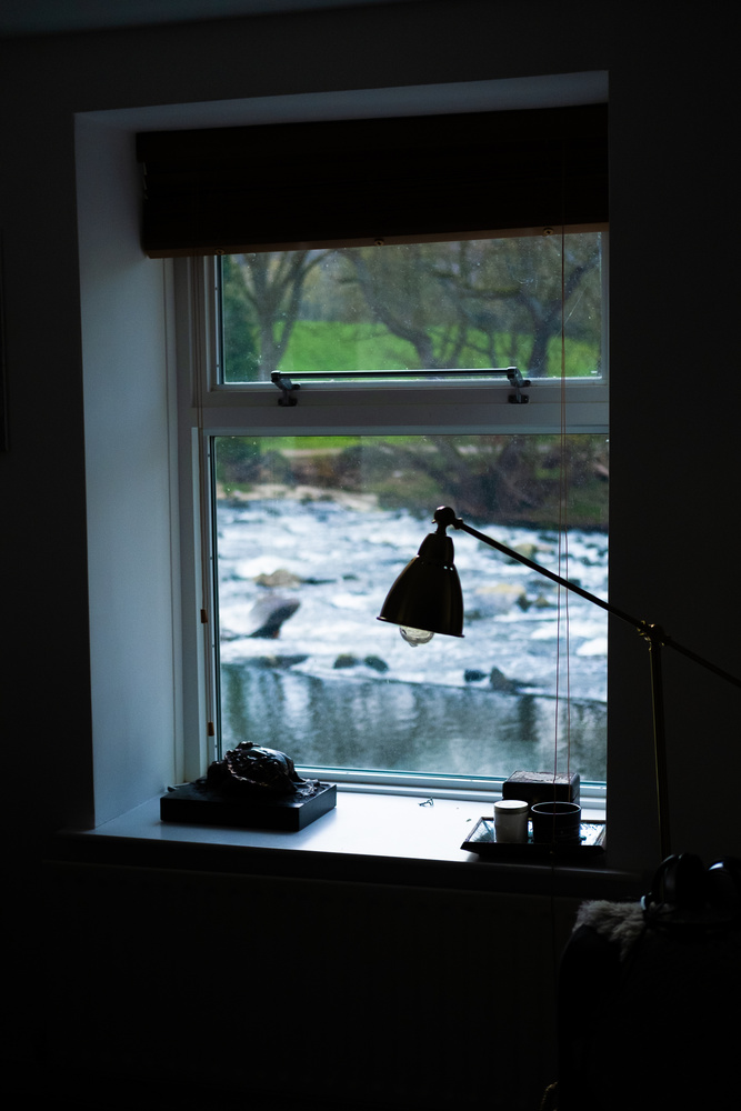 A window with a river in the background