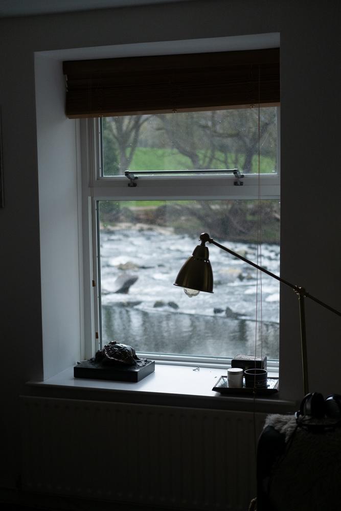 A window facing a river