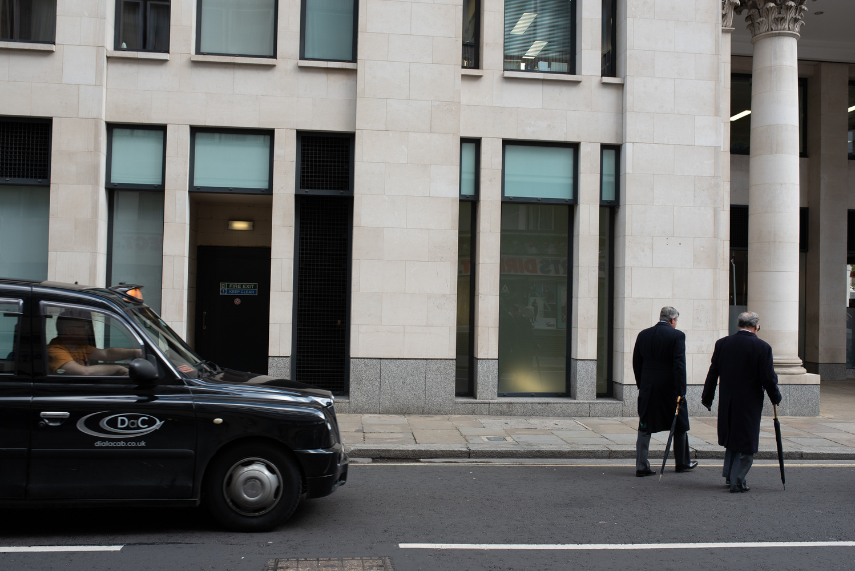 Two men crossing the road in London