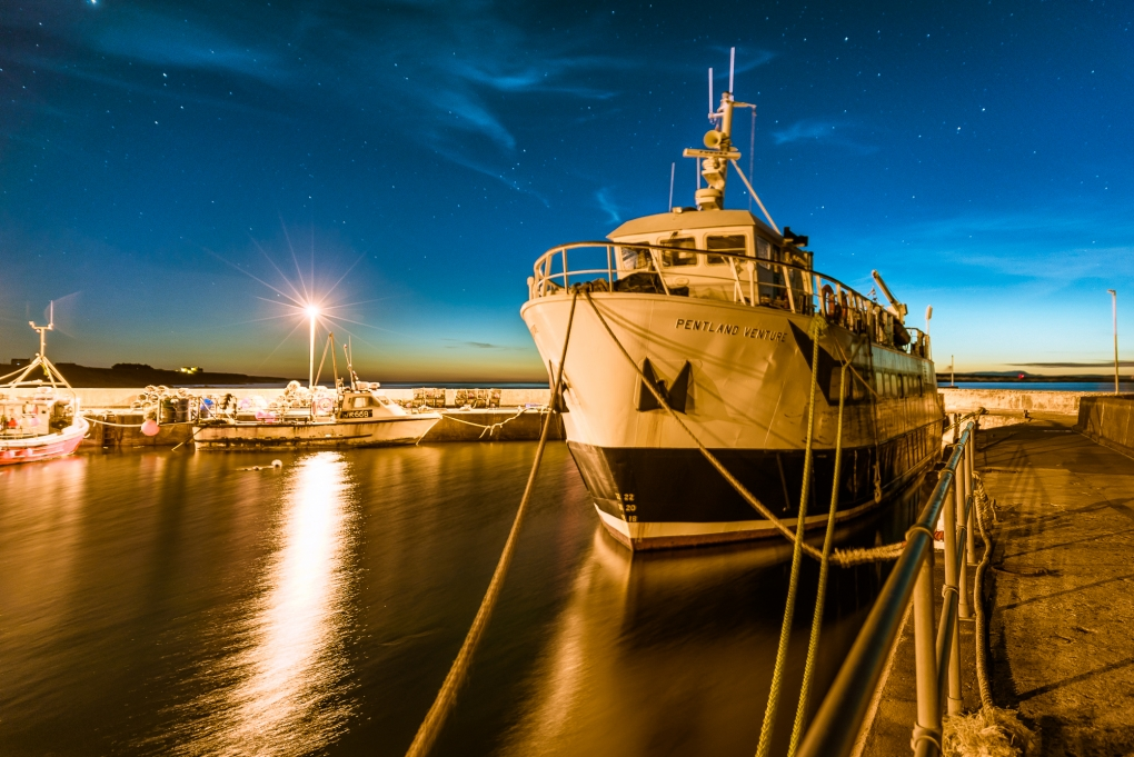 Ferry at night by Mo Pla