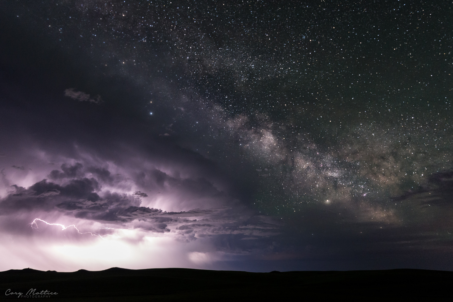 Milky Way Rising Above a Thunderstorm by Cory Mottice