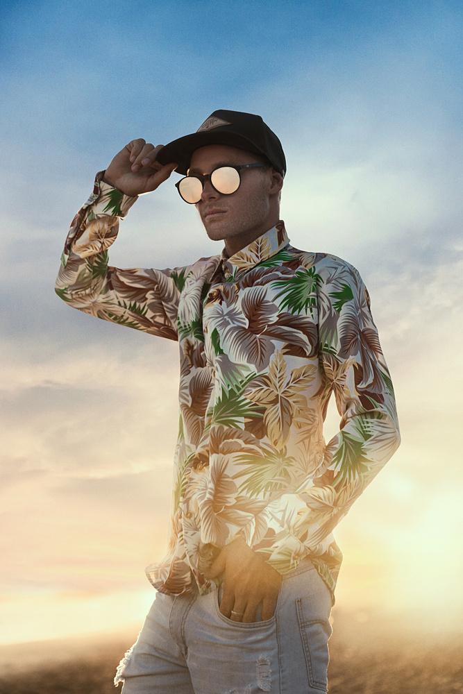 man from the beach and the sun by Mikeila Borgia