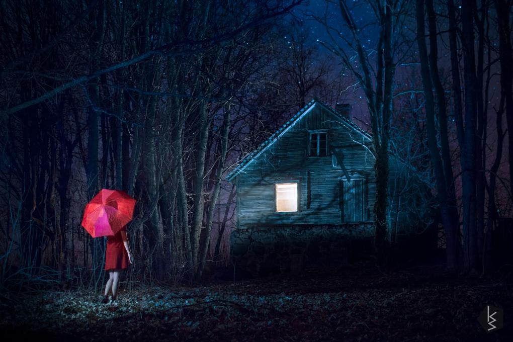 Red umbrella. by Kristaps Bardzins