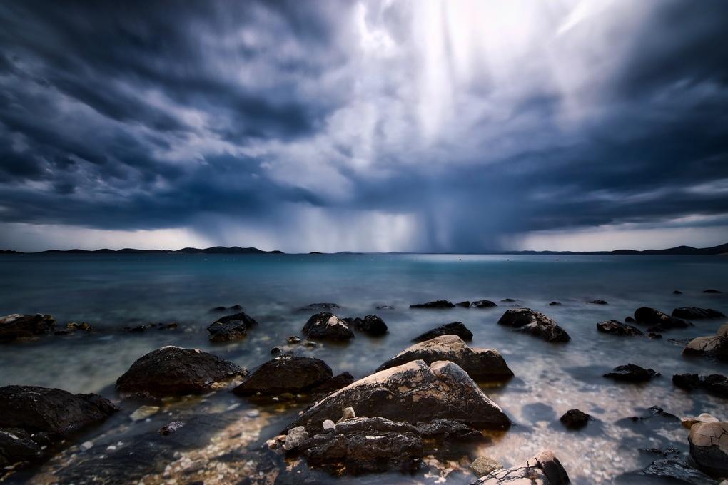 Clear water stormy clouds by Luka Jazić