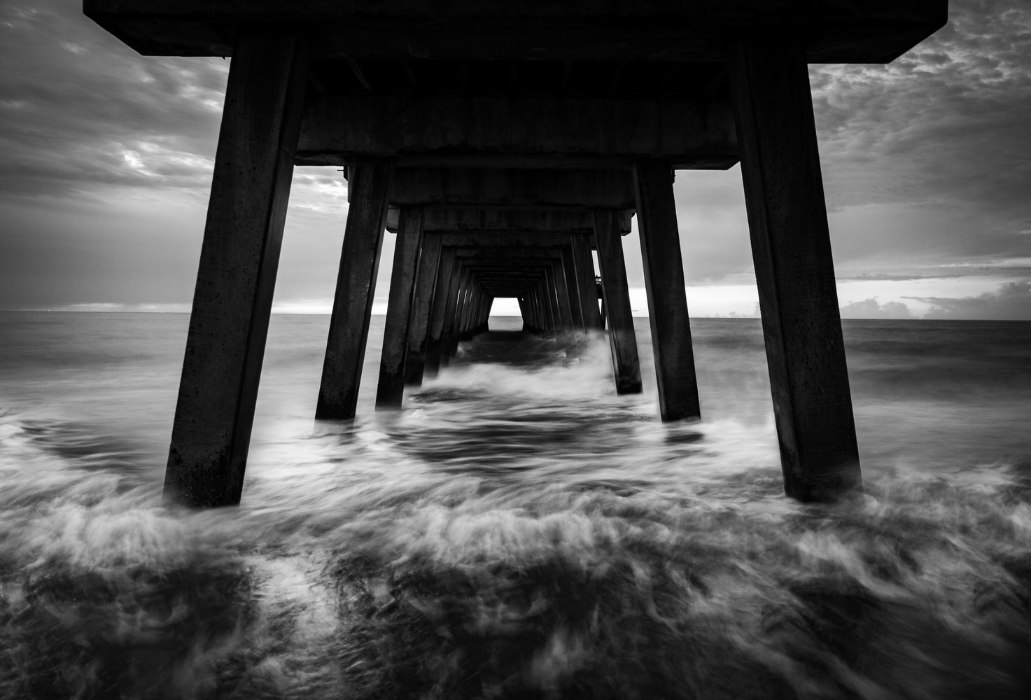 Waves Crashing Under the Pier by Troy Marcy