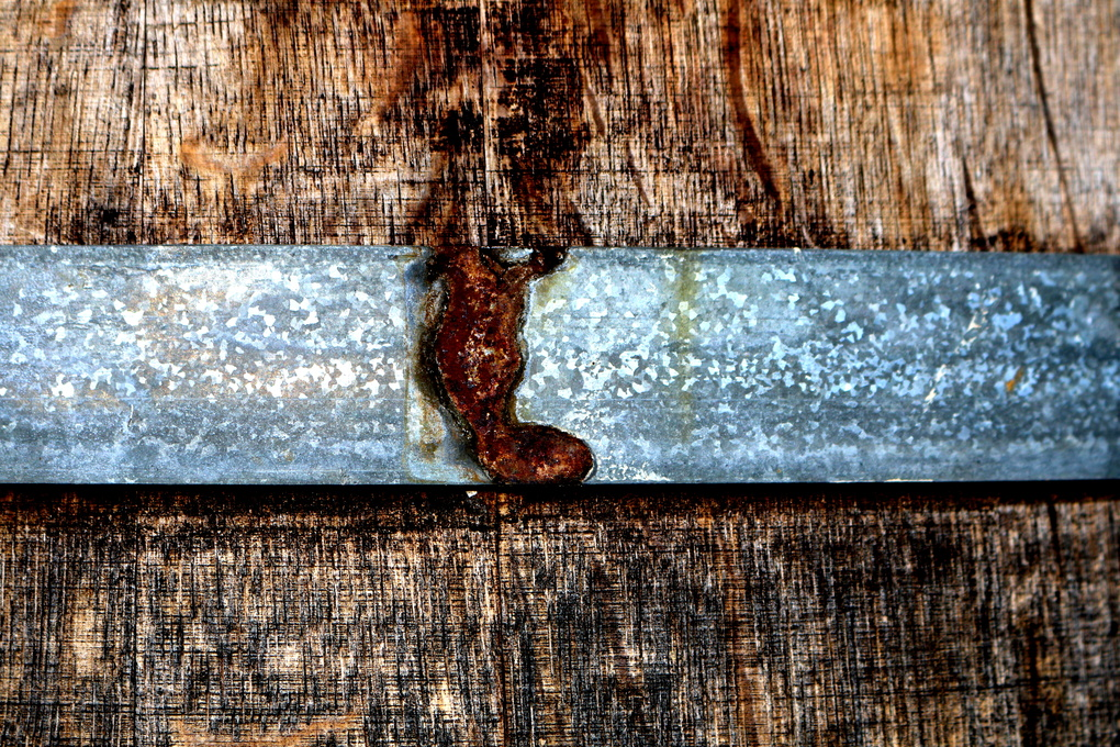Rusted Band on Wooden Barrel by Renee Olmsted