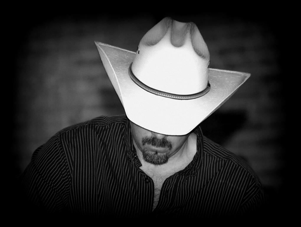 Cowboy in Straw Hat by Renee Olmsted
