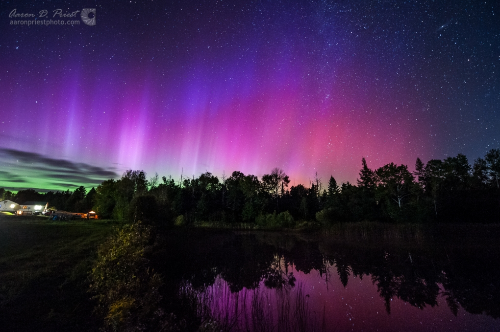 Aurora borealis over my back yard pond in Lee, Maine by Aaron Priest